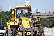 Construction Worker Driving Front-End Loader