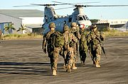 US Marines and a Sea Knight Helicopter, Clark Air Base, the Philippines