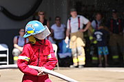 Fire Fighter Holding Hose for Water Battle