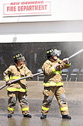 Fire Fighters with Water Hose