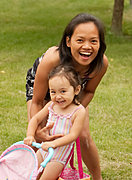 Mother and Daughter Playing in a Yard