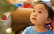 Toddler Looking up at Christmas Tree