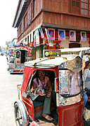 Woman Paying Trike Driver in Vigan, Philippines