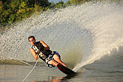 Man Waterskiing on One Ski