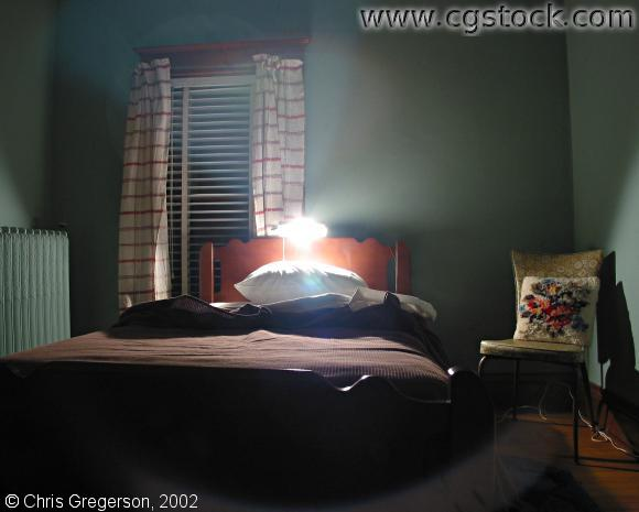 Dark Bedroom with Reading Light