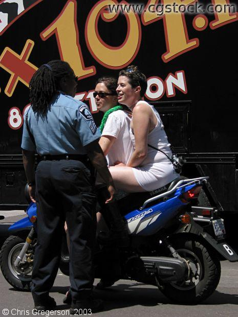 Police Officer and Women on a Motorcycle