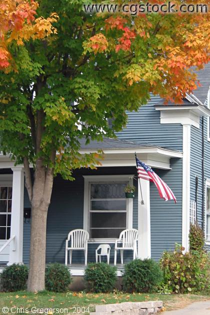 Porch with an American Flag in Autumn