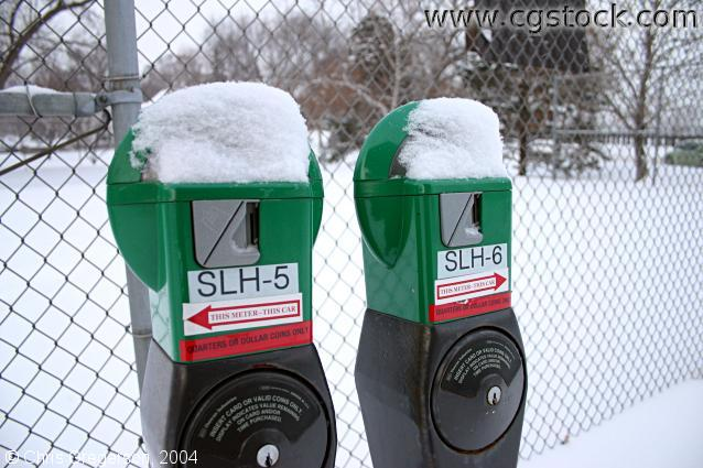 snow,park,parking,winter,meters,green,red,white,tennis court,parking lot,icy,cold,fence