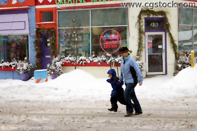 Storefront, Woman and Child Crossing Street