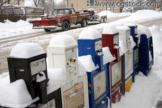 Newspaper Racks Covered in Snow