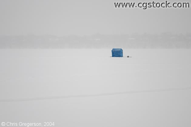Icefishing house on a Frozen Lake