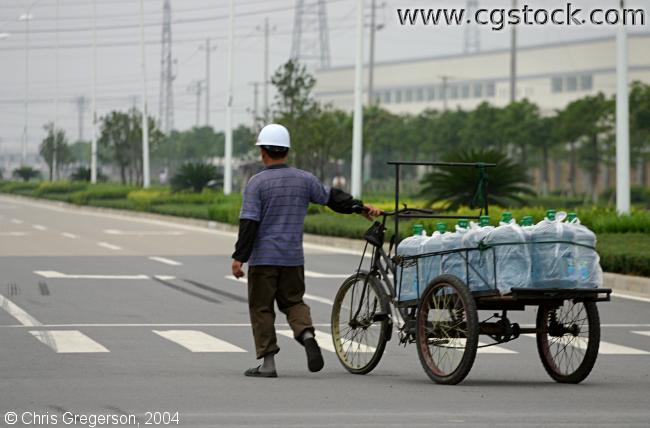 Man Transporting Bottled Water