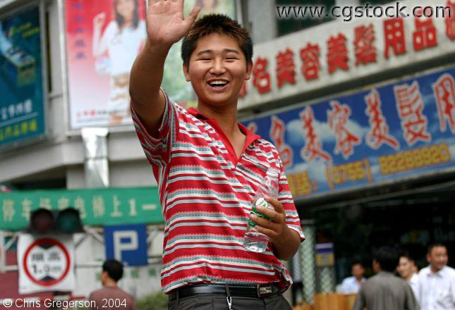 Chinese Teenager Waving and Smiling