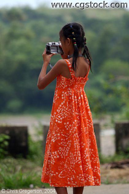 Young Girl Using a Digital Camera