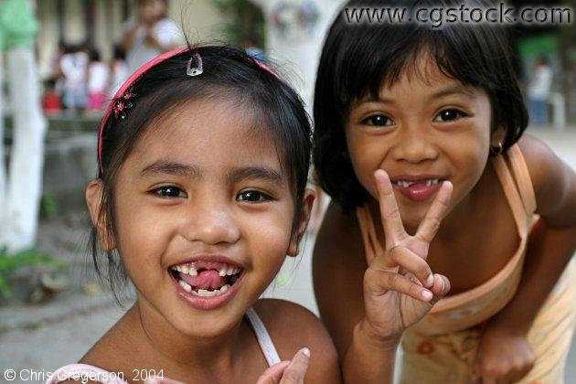 Portrait of Two Filipinas Girls in a Schoolyard
