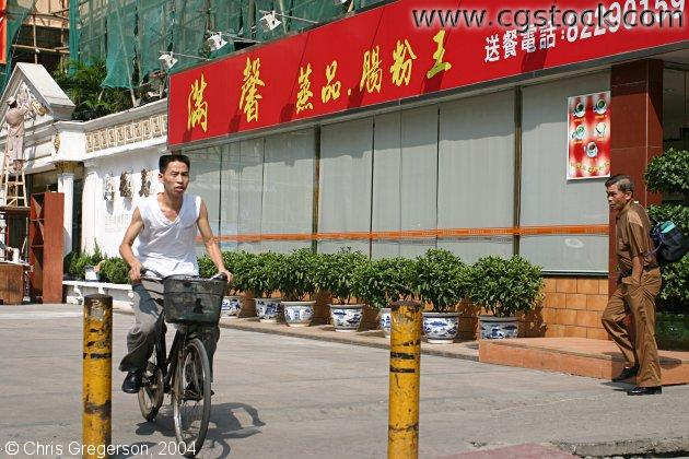 Chinese Bicycle Commuter on Sidewalk