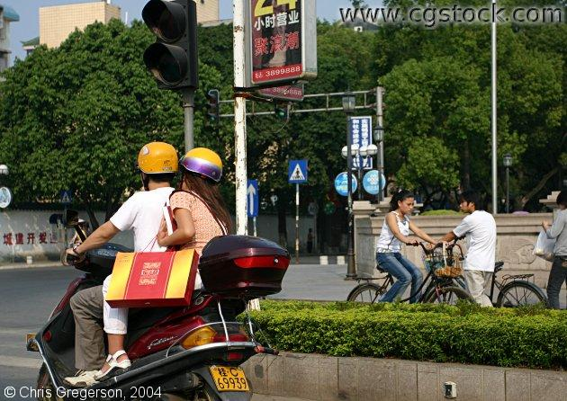 Couple on Scooter after Shopping