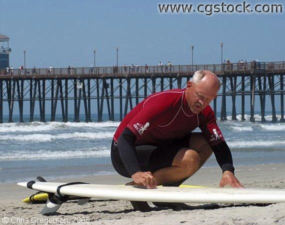 Man Waxing Surfboard, Oceanside, California