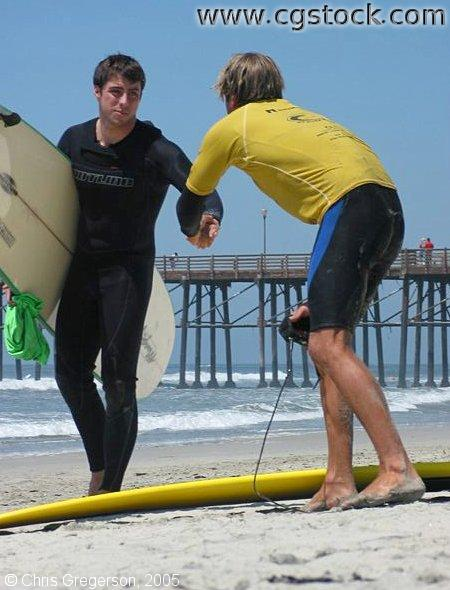 Men Shaking Hands Before Surfing Competition