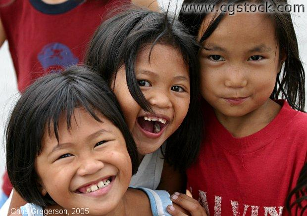 Three Filipina Girls Laughing