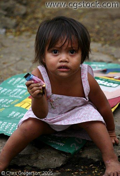 Street Child Holding Food