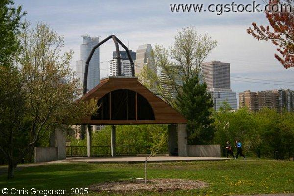 Joggers in Park with Minneapolis Skyline