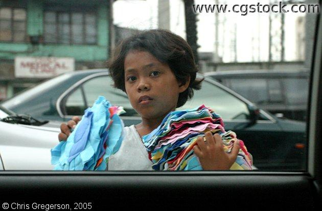 Child Selling Rags in the Streets of Manila