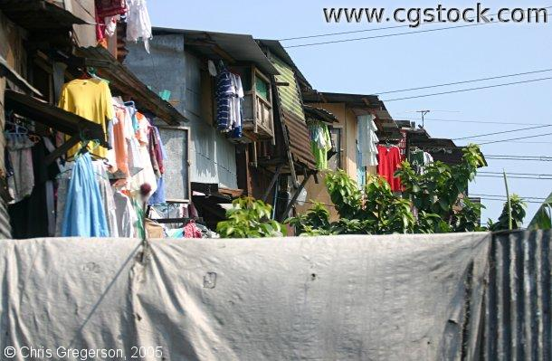 Row of Shanties with Colored Laundry