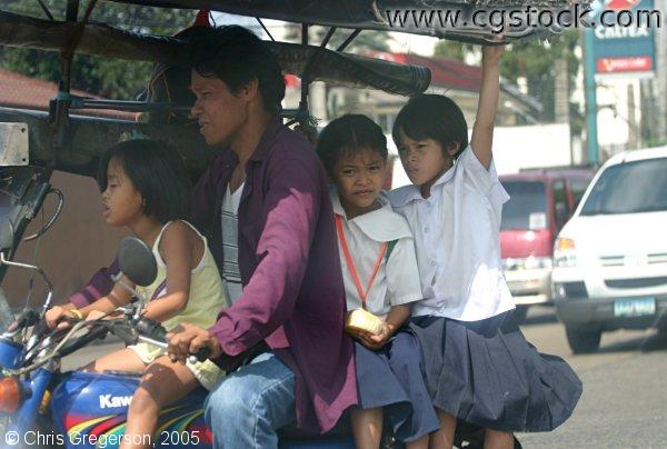 Four People on a Motorcycle in Manila