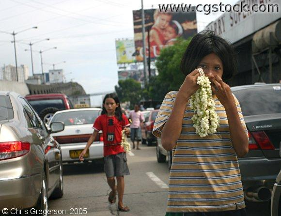 Girls Selling Flower Necklaces to Cars, Manila