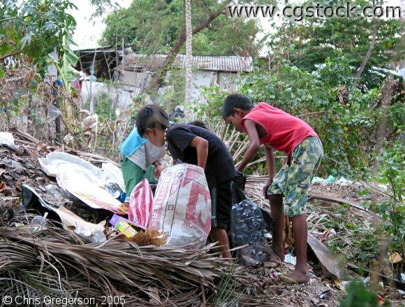 Boys Looking Through Trash, the Philippines