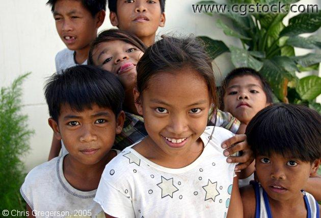 Young Kids Smiling in the Streets of the Philippines