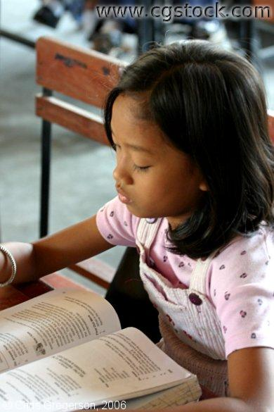 Elementary Student Reading, Siteo Pader School