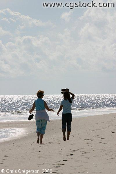 Women Walking Together on the Beach