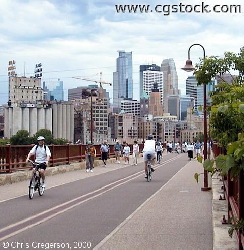 Skyline and People on the Stone Arch Bridge