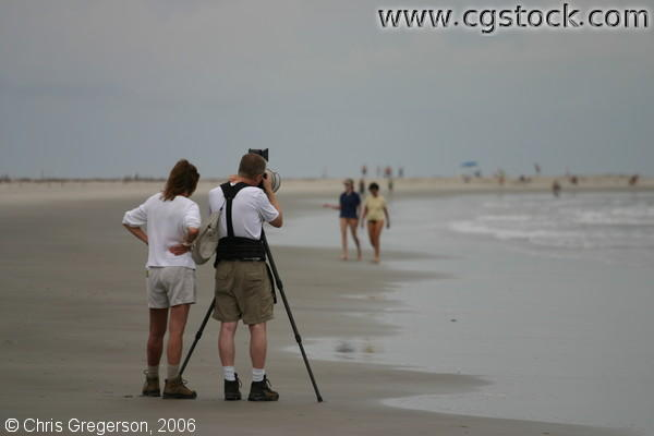 Photographer-Couple Taking Photos on the Beach