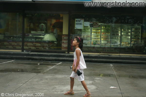 Young Girl Walking Past Shops, Angeles City