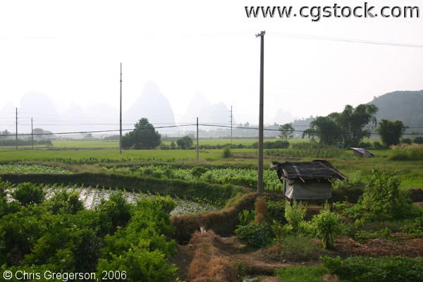 Rural Chinese Farm Fields Among Kurst Mountains