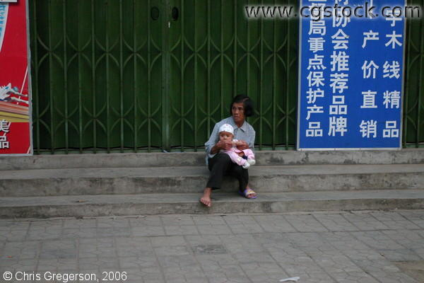 Chinese Grandmother and Infant, Alone on Steps