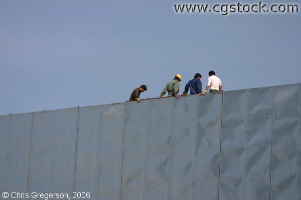 Chinese Construction Workers on High-Rise