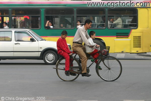Chinese Father and Sons on Bike Together