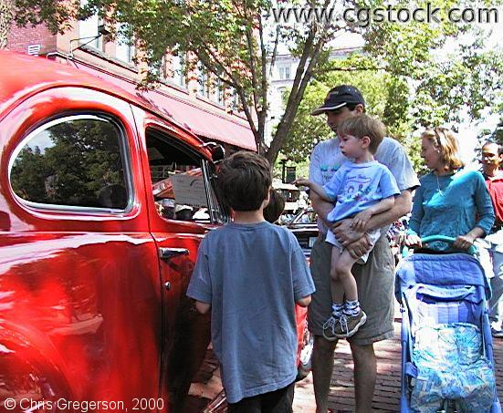 Family Admiring Car