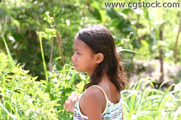 Brown-Skinned Girl on an Area with Thick Vegetation