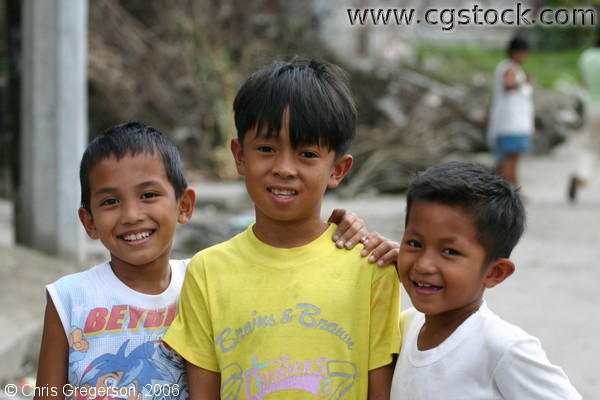 Three Filipino Young Boys Smiling Standing on the Street