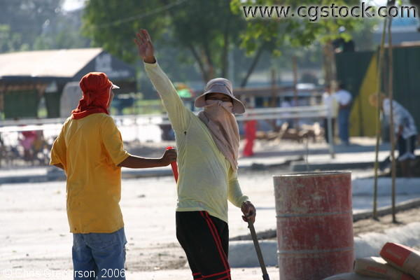 Picture of Two Men Working on the Grounds of a Construction Site