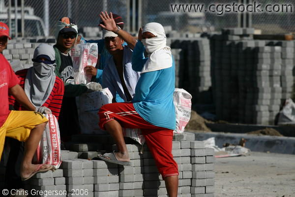 Picture of Construction Workers Amidst Concrete Blocks