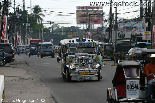 MacArthur Highway and a Jeepney, the Common Public Transportation in the Philippines