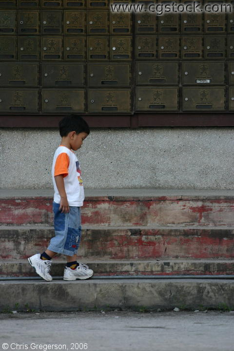 A Filipino Boy Walking by the Post Office of Balibago