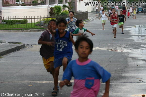 Children Running on a Street in Balibago town in Angeles City, Pampanga