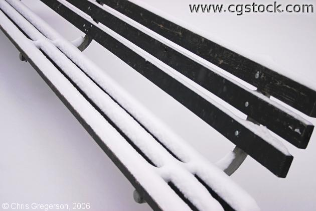 Park Bench Covered in Snow